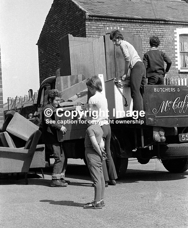 Roman Catholic families evacuate from Chief Street, Belfast, N Ireland, UK, because of continuing rioting. They are being put up in a local school hall. 197006000225a.<br /> <br /> Copyright Image from Victor Patterson, Belfast, UK<br /> <br /> t: +44 28 9066 1296 (from Rep of Ireland 048 9066 1296)<br /> m: +44 7802 353836<br /> e: victorpattersonbelfast@gmail.com<br /> <br /> www.images4media.com<br /> <br /> Please see my full Terms and Conditions of Use at https://www.images4media.com/p/terms-conditions - it is IMPORTANT that you familiarise yourself with them.<br /> <br /> Images used online incur an additional cost. This cost should be agreed in writing in advance. Online images must be visibly watermarked i.e. © Victor Patterson or that of the named photographer within the body of the image. The original metadata must not be deleted from images used online.<br /> <br /> This image is only available for the use of the download recipient i.e. television station, newspaper, magazine, book publisher, etc, and must not be passed on to a third party. It is also downloaded on condition that each and every usage is notified within 7 days to victorpattersonbelfast@gmail.com.<br /> <br /> The right of Victor Patterson (or the named photographer) to be identified as the author is asserted in accordance with The Copyright Designs And Patents Act (1988). All moral rights are asserted.