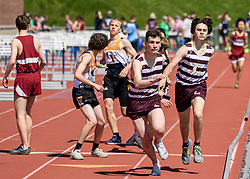 Lebanon freshman Justin Decarlo, right, passes the baton to junior Will Foreman in the boys 4 X 800 relay in the NHIAA Division II track and field championship at UNH on Saturday, May 25, 2019.  (Alan MacRae/Valley News)