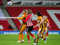 Hull City's Josh Magennis vies for possession with Sunderland's Dion Sanderson<br /> <br /> Photographer Alex Dodd/CameraSport<br /> <br /> The EFL Sky Bet League One - Sunderland v Hull City - Saturday 9th January 2021 - Stadium of Light - Sunderland<br /> <br /> World Copyright © 2021 CameraSport. All rights reserved. 43 Linden Ave. Countesthorpe. Leicester. England. LE8 5PG - Tel: +44 (0) 116 277 4147 - admin@camerasport.com - www.camerasport.com