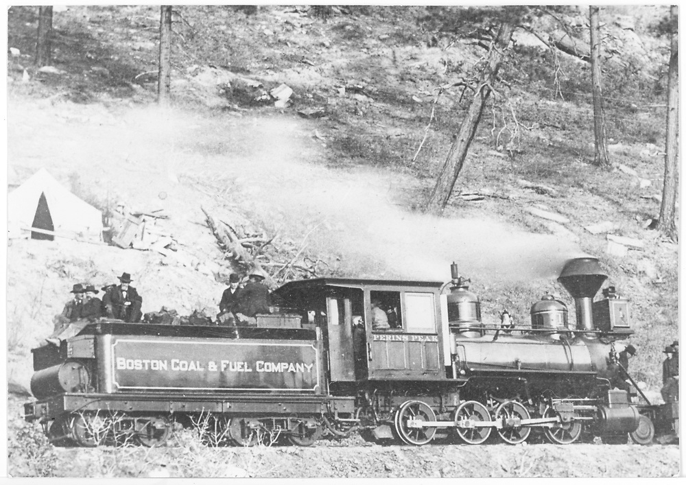"""Boston Coal and Fuel Co. Consolidation #1 with flat cars loaded with excursioners on the occasion of the coal mine railroad's opening day.<br /> Boston Coal & Fuel  Perins Peak (later Calumet Branch), CO  Taken by Gonnen, Frank - 11/25/1901<br /> In book """"RGS Story, The Vol. XI: Durango and the Perins Peak Branch"""" page 328<br /> Also in """"Narrow Gauge Country 1870-1970"""", p. 193; """"The Rio Grande Southern Story"""", p. 76 and p. 154; """"Colorado's Mountain Railroads"""", p. 29 and """"Rio Grande ? to the Pacific"""", p. 281.<br /> Thanks to Don Bergman for additional information."""