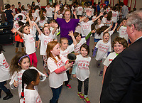 Pleasant Street School students celebrate with Larry Johnston after hearing their school received the NH Elementary School of the Year award on Friday morning.  (Karen Bobotas/for the Laconia Daily Sun)