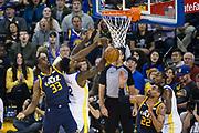 Utah Jazz center Ekpe Udoh (33) blocks a shot by Golden State Warriors forward Jordan Bell (2) at Oracle Arena in Oakland, Calif., on December 27, 2017. (Stan Olszewski/Special to S.F. Examiner)