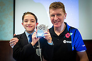British Astronaut Tim Peake pictured with Jude Young from Clifton College in Bristol during the UK Space Agency Schools Conference hosted by the University of Portsmouth at the Guildhall in the city. Jude is holding an AstroPi computer which he programmed and was used as an mp3 player during Peake's six months aboard the International Space Station.<br /> The conference celebrated the work of over a million UK school students inspired by Peake's Principia mission, which saw the flight dynamics and evaluation graduate spend more than six months on board the International Space Station.<br /> Youngsters had the chance to present their work through talks and exhibitions to experts from the UK Space Agency, European Space Agency (ESA), partner organisations and the space sector. Most also had the chance to meet Tim.<br /> Picture date Wednesday 2nd November, 2016.<br /> Picture by Christopher Ison for the University of Portsmouth.<br /> Contact +447544 044177 chris@christopherison.com