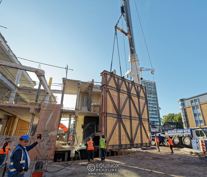 London, United Kingdom - 20 September 2019<br /> EXCLUSIVE SET - Aerial construction specialists and demolition experts use a huge crane to carefully lift intact, a twenty five ton, two-story wall, to preserve a famous Banksy rat image which has been covered up for years. Teams from specialist companies have spent over six weeks cutting around the artwork and fitting custom made eight ton steel supports to enable them to save the historic piece of art. Work has started on the construction of a new twenty seven floor art'otel hotel on the site of the old Foundry building in Shoreditch, east London, and a condition of the planning permission was to preserve the historical Banksy graffiti. A second section of the painting, an image of a TV being thrown through a broken window has already been cut out and moved separately. After the hotel construction is complete the two parts of the Banksy painting will be displayed on the hotel. Our pictures show the stages of work to protect the image, culminating in the lifting of the three story wall by crane. Video footage also available.<br /> (photo by: EQUINOXFEATURES.COM)<br /> Picture Data:<br /> Photographer: Equinox Features<br /> Copyright: ©2019 Equinox Licensing Ltd. +443700 780000<br /> Contact: Equinox Features<br /> Date Taken: 20190920<br /> Time Taken: 17102338<br /> www.newspics.com