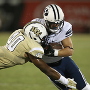 ORLANDO, FL - OCTOBER 09: Chequan Burkett #40 of the UCF Knights tackles Mitchell Juergens #87 of the Brigham Young Cougars during the second quarter of their NCAA football game at Bright House Networks Stadium on October 9, 2014 in Orlando, Florida. (Photo by Alex Menendez/Getty Images) *** Local Caption ***Chequan Burkett; Mitchell Juergens