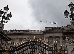 © Licensed to London News Pictures. 04/06/2012. London, UK. .Vintage Planes fly over Buckingham palace on the Final Day of the Queens Diamond Jubilee..The Royal Jubilee celebrations. Great Britain is celebrating the 60th  anniversary of the countries Monarch HRH Queen Elizabeth II accession to the throne this weekend. Photo credit : Rich Bowen/LNP