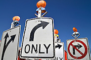 Traffic control signs await placement at a road construction site, Tucson, Arizona, USA.