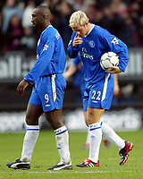 Photograph: Scott Heavey.<br /> Charlton Athletic v Chelsea. FA Barclaycard Premiership. 26/12/2003.<br /> The two Chelsea strikers, Jimmy Floyd Hasselbaink and Eidur Gudjohnsen (R) trundle off after the 4-2 defeat