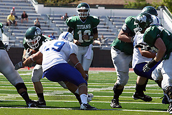 17 September 2011: Dan Howell plugs the hole Cameron Blossom is trying to exploit during an NCAA Division 3 football game between the Aurora Spartans and the Illinois Wesleyan Titans on Wilder Field inside Tucci Stadium in.Bloomington Illinois.
