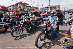 Albert Diaz  and Stacy McCleary leaving the Broken Spoke on the Run to the Line for lunch and biker vs Cowboy rodeo games at the Spur Creek Ranch in Newell during the annual Sturgis Black Hills Motorcycle Rally.  SD, USA. Wednesday August 9, 2017. Photography ©2017 Michael Lichter.