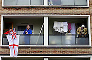 Tower block residents on their balconies, East End of London, UK
