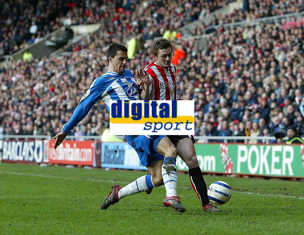Photo: Andrew Unwin.<br />Sunderland v Wigan Athletic. The Barclays Premiership. 11/03/2006.<br />Wigan's Paul Scharner (L) looks to tackle Sunderland's George McCartney (R).