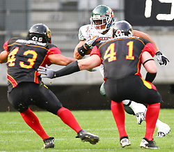 08.07.2011, Tivoli Stadion, Innsbruck, AUT, American Football WM 2011, Group A, Germany (GER) vs Mexico (MEX), im Bild the german defenders Steve Nzeocha (Germany, #43, LB) and Mario Nowak (Germany, #41, LB) wait for the run from Barrera Jonathan alejandro (Mexico, #23, RB)  // during the American Football World Championship 2011 Group A game, Germany vs Mexico, at Tivoli Stadion, Innsbruck, 2011-07-08, EXPA Pictures © 2011, PhotoCredit: EXPA/ T. Haumer