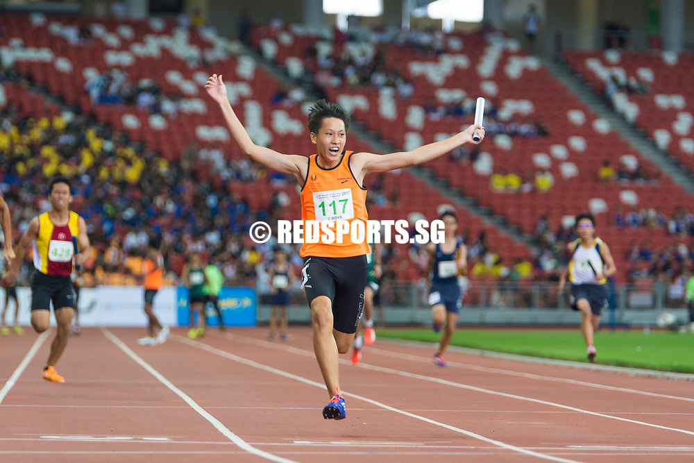 Jeff Tay (#117) of Singapore Sports School finishes the race in the C Division 4 x 100m relay final, earning them the gold medal with a timing of 00:44.92. (Photo © Jerald Ang/Red Sports)