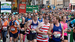 © Licensed to London News Pictures. 03/10/2021. London, UK. Runners pass through Greenwich town centre as they take part in the 2021 London Marathon.This London Marathon will be the first full scale staging of the race in more than two years due to the Coronavirus Pandemic.  Photo credit: George Cracknell Wright/LNP
