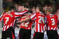 Photo: Pete Lorence.<br />Lincoln City v Rochdale United. Coca Cola League 2. 21/10/2006. <br />Jamie Forrester celebrates his first goal of the match, leading the squad to a 7-1 victory.