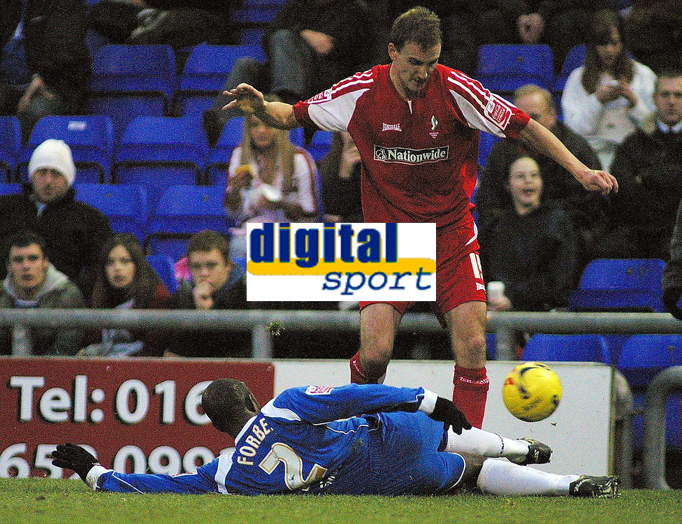 Photo: Paul Thomas.<br /> Oldham Athletic v Swindon Town. Coca Cola League 1.<br /> 10/12/2005.<br /> Andy Nicholas (R) of Swindon tries to get past Terrel Forbes.