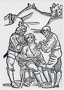 Surgeon treating a wounded soldier. Woodcut from a book on field surgery, 1593.