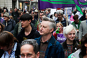 Well known socialist and singer Billy Bragg. Peaceful demonstration along Piccadilly in central London by protesters during the TUC union march against cuts, Saturday March 26th 2011. Around 400,000 people joined the TUC's March for the Alternative to oppose the coalition government's spending cuts. Teachers, nurses, midwives, NHS, council and other public sector workers were joined by students and pensioners to bring the centre of the capital to a standstill and to make their point that the current coalition government is making cuts too fast which they suggest will have a catastrophic effect on jobs and economic recovery.