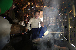 Starting a fire of sticks to cook the lunch time meal themselves. Some students are supported by Plan International, especially if they require secondary education but live too far from school.  They currently live in very simple home-made grass huts, but Plan is building two dorms with the support of the European Union, Pong lath  Secondary school, Pha Oudom District, Bokeo Province, Lao PDR
