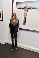 LEVI YOUNG daughter of singer Paul Young at a private view of photographs 'Terry O'Neill-The Best Of' held at The Little Black Gallery, 13A Park Walk, London on 16th January 2014.