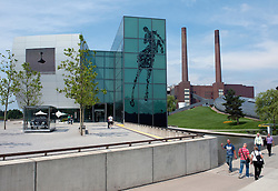 Car museum and power station to rear at Autostadt in Wolfsburg Germany