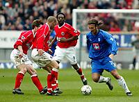 Photo. Chris Ratcliffe<br />Charlton v Birmingham. FA Premiership. 19/04/2003<br />Any way through? Christophe Dugarry attacks Charlton's Scott Parker and Luke Young