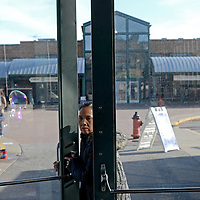 A women enters one of the buildings that is part of the Kansas City, City Market. The building housed artist selling their crafts. The City Market offers visitors a variety of shopping options from fruit vendors to thrift clothes stands.