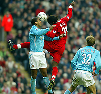 Liverpool's Salif Diao and Sunderland's Phil Babb during the Premiership match at Anfield, Liverpool, Sunday, November 17th, 2002. <br /><br />Pic by David Rawcliffe/Propaganda<br /><br />Any problems call David Rawcliffe on +44(0)7973 14 2020 or email david@propaganda-photo.com - http://www.propaganda-photo.com
