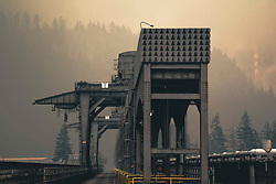 September 5, 2017 - Bonneville, OR, United States of America - Heavy smoke from the Eagle Creek Fire hangs over the Bonneville Lock & Dam complex on the Columbia River September 5, 2017 in Bonneville, Oregon. The fire is burning 30,000 acres of forest unchecked in the Columbia River Gorge national scenic area. (Credit Image: © Karim Delgado/Planet Pix via ZUMA Wire)