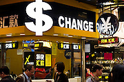 HONG KONG, MARCH 18: A currency exchange booth shows symbols of different currencies including Hong Kong dollars and Chinese yuans (RMB), on March 18, 2015, in Hong Kong. (Photo by Lucas Schifres/Pictobank)