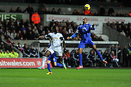Everton's Sylvain Distin ® beats Swansea's Wilfried Bony to a header. Barclays Premier league, Swansea city v Everton at the Liberty Stadium in Swansea,  South Wales on Sunday 22nd Dec 2013. pic by Andrew Orchard, Andrew Orchard sports photography.