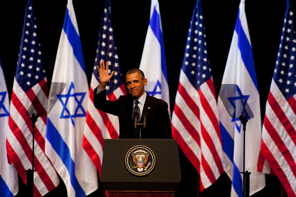 U.S. President Barack Obama waves for the crowd before his speech at the Jerusalem Convention Center in Jerusalem, Israel, on March 21, 2013.