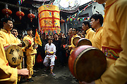 """PUTIAN, CHINA - FEBRUARY 20: <br /> <br /> Mans back Beaten With Thorny Iron Ball during Ceremony <br /> <br /> A man acts as being possessed by gods during the \""""Da Tie Qiu\"""" (Beat with iron ball) event at Baitang Town on February 20, 2017 in Putian, Fujian Province of China. Villagers in Putian hold the \""""Da Tie Qiu\"""" event on Feb 24 in lunar calendar to commemorate Qi Jiguang, a national hero in Ming dynasty. During the event, selected unmarried men baring their upper bodies and feet sit on the knife-made palanquins and beat their backs with thorny iron balls. Beating back with an iron ball stuck with 360 steel nails is said to encourage men to guard the safety of their home and country.. <br /> ©Exclusivepix Media"""