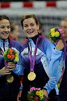 Håndball<br /> 11. August 2012<br /> Olympiske Leker , London<br /> Finale<br /> Norge - Montenegro<br /> Kari Mette Johansen (L) og Linn-Kristin Riegelhuth Koren (R) , Norge feirer gull medaljen<br /> Foto : Astrid M. Nordhaug