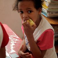 South America, Brazil. Rio de Janeiro. A young girl at Para Ti school in Favela of Vila Canoas.