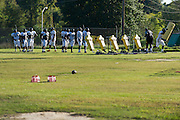 """The Grambling State University football team goes through drills with interim head coach Dennis """"Dirt"""" Winston in Grambling, Louisiana on October 23, 2013. Winston is the third head coach in the past five weeks for the Tigers.  (Cooper Neill for The New York Times)"""