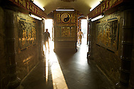Visitors enter and exit the underground hallway that leads to Guandu Daoist Temple, in Taipei, Taiwan.