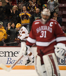 November 17, 2017 - Minneapolis, MN, USA - Minnesota's Brent Gates Jr. (10) crashes into the boards to celebrate his first-period goal against Harvard on Friday, Nov. 17, 2017, at the 3M Arena at Mariucci in Minneapolis. (Credit Image: © Aaron Lavinsky/TNS via ZUMA Wire)