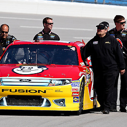 April 17, 2011; Talladega, AL, USA; Crew members for NASCAR Sprint Cup Series driver Trevor Bayne (21) push the car to the starting line before the Aarons 499 at Talladega Superspeedway.   Mandatory Credit: Derick E. Hingle