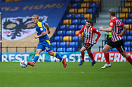 AFC Wimbledon midfielder Jaakko Oksanen (16) passing the ball in front of Dons banner during the EFL Sky Bet League 1 match between AFC Wimbledon and Sunderland at Plough Lane, London, United Kingdom on 16 January 2021.