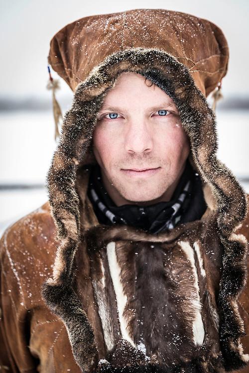 Travis dressed in indigenous garb.