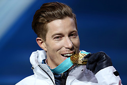 USA's Shaun White with his gold medal after victory in the Men's Halfpipe Snowboard during the medal ceremony at the Medal Plaza during day five of the PyeongChang 2018 Winter Olympic Games in South Korea. PRESS ASSOCIATION Photo. Picture date: Wednesday February 14, 2018. See PA story OLYMPICS Snowboard Halfpipe. Photo credit should read: Mike Egerton/PA Wire. RESTRICTIONS: Editorial use only. No commercial use.