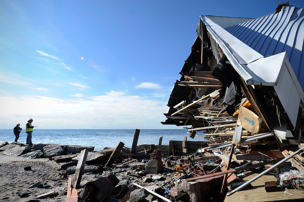 Engineers stand next to the destroyed home of Benjamin Barton as they assess damage to homes from Hurricane Sandy along Fairfield Beach Road in Fairfield, Conn. (AP Photo/Jessica Hill)