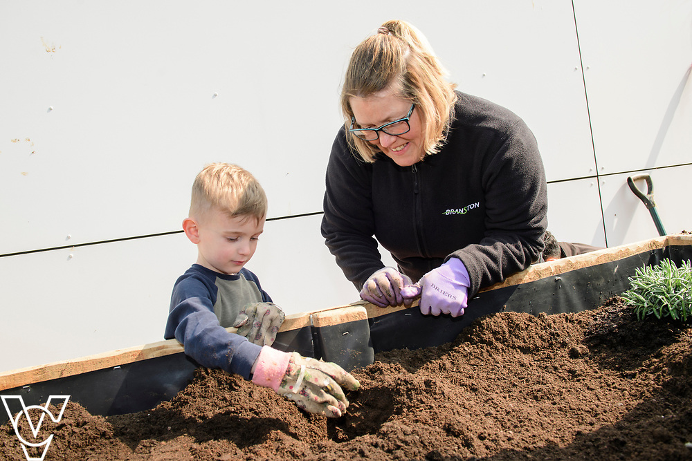 Colleagues from Branston Ltd have created a sensory garden at Branston Academy Nursery.<br /> <br /> Picture: Chris Vaughan Photography for Branston Ltd<br /> Date: April 8, 2019
