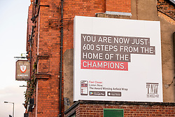 """LIVERPOOL, ENGLAND - Thursday, October 1, 2020: An advert for Liverpool supporters' podcast The Anfield Wrap, on the side of the Glenbuck Hotel in Anfield. """"You are now just 600 steps from the home of the Champions"""". (Pic by David Rawcliffe/Propaganda)"""