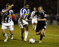 Photo: Chris Ratcliffe.<br /> Colchester United v Swansea City. LDV Vans Trophy. 14/03/2006.<br /> Andy Robinson (R) of Swansea gets away from Neil Danns (C) and Liam Chilvers of Colchester
