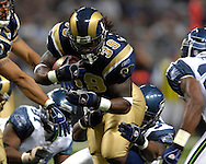 St. Louis Rams running back Steven Jackson (39) fights for yardage against Seattle at the Edward Jones Dome in St. Louis, Missouri, October 15, 2006.  The Seahawks beat the Rams 30-27.<br />