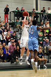 20 February 2016:  A jumpsuit by Andy Stempel(4) clears defender Pat Coleman during an NCAA men's division 3 CCIW basketball game between the Elmhurst Bluejays and the Illinois Wesleyan Titans in Shirk Center, Bloomington IL