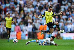 Chris Maguire of Oxford United leaps over Dion Kelly-Evans of Coventry City - Photo mandatory by-line: Jason Brown/JMP -  02/04//2017 - SPORT - Football - London - Wembley Stadium - Coventry City v Oxford United - Checkatrade Trophy Final